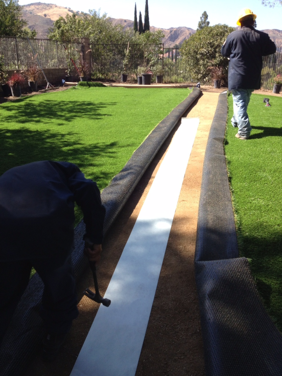 Artificial turf install process - now installing
