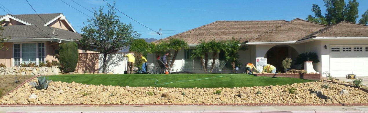 Turf being installed in the front yard